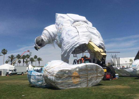 3028987-slide-i-2-learn-the-story-of-the-giant-coachella-astronaut-roaming-the-festival-grounds