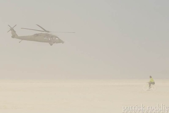 Blackhawk military helicopter hovers low over Burning Man, 2013