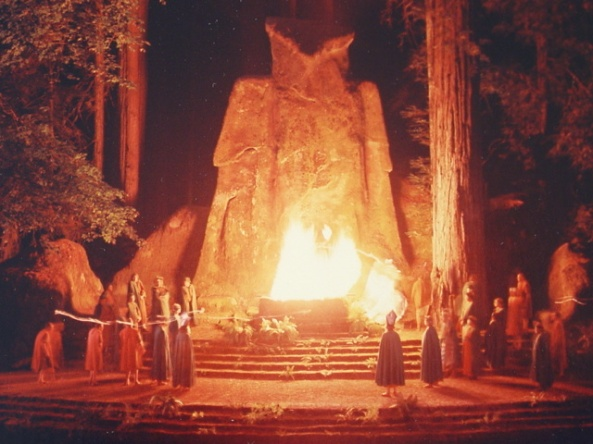 Lamp lighters in robes set fire to an effigy of the god Moloch in a ritual ceremony at Bohemian Grove